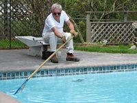 Another satisfied Clearwater Pools customer enjoys his newly renovated pool.